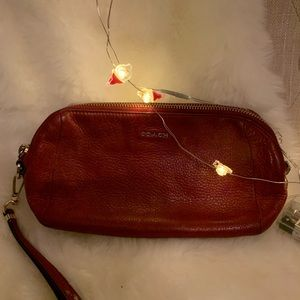 An authentic Coach small leather pouch.